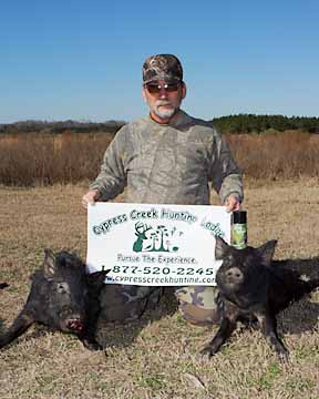 Mike with his two meat hogs