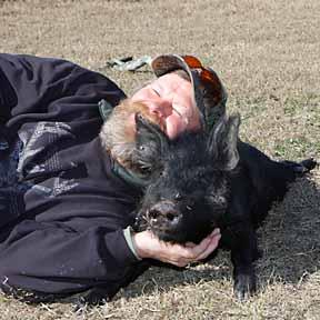 James snuggling his hog