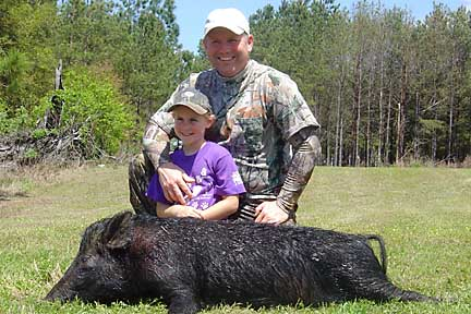 Eric with his daughter and her first hog