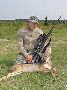 Guy with his boggy Creek coyote